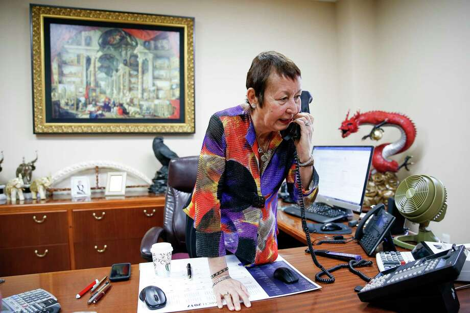 Gorham Group Industrial CEO Marlene Sarras talks on the phone in her office Friday, March 31, 2017 in Houston. Sarras relies on the H1B visa program to employ engineers from Argentina to work on specialized fertilizer plants. ( Michael Ciaglo / Houston Chronicle) Photo: Michael Ciaglo, Staff / Michael Ciaglo