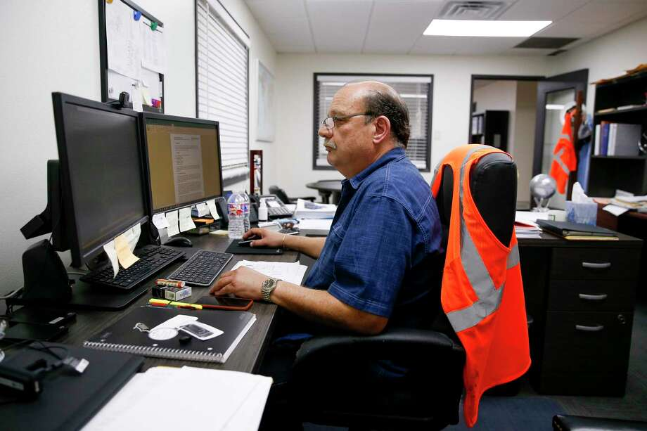Gorham Group Industrial project director Mario Monetta works on the computer in his office Friday, March 31, 2017 in Houston. Monetta, who is from Argentina, is here in the United States through the H1B visa program to work on specialized fertilizer plants. ( Michael Ciaglo / Houston Chronicle) Photo: Michael Ciaglo, Staff / Michael Ciaglo
