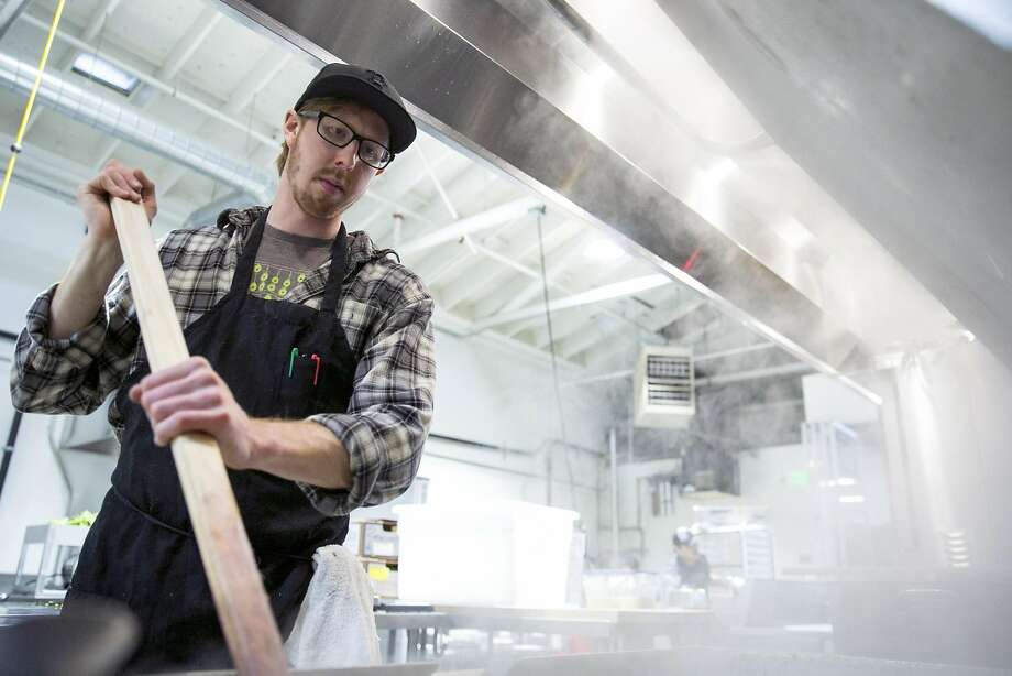 Good Eggs kitchen manager Brendan Evje prepares farro at Kitchentown, a San Mateo food incubator and commercial kitchen. Photo: Santiago Mejia, The Chronicle