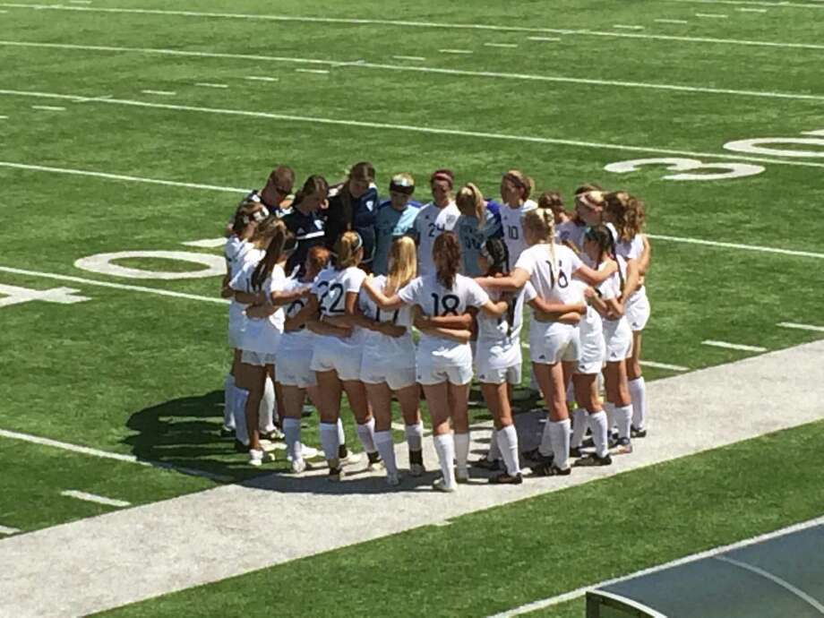 The Kingwood Lady Mustangs huddle before their regional semifinal match against Tompkins Firday, March 7 at Abshier Stadium in Deer Park Photo: Elliott Lapin