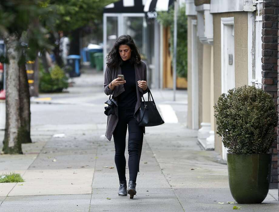 Angie Gontaruk walks to her job at the CSpence Group video production company in San Francisco. Photo: Paul Chinn, The Chronicle