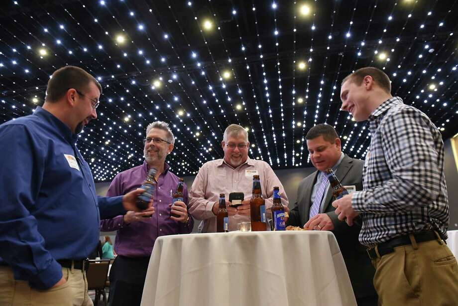 Employees from Graybar, from left, Patrick Stark, Farley, Jack DeNyse, Kyle Koch and Steve Martin enjoy a cocktail hour during the Top Workplaces awards reception at the Albany Capital Center Thursday, April 6, 2017 in Albany, N.Y. Graybar is an electrical supply store in Albany. (Lori Van Buren / Times Union) Photo: Lori Van Buren / 20040184A