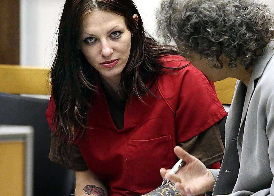 Alix Tichelman, left, 26, of Folsom, Calif., confers with public defender Diane August, right, during her arraignment in Santa Cruz Superior Court Wednesday, July 9, 2014, in Santa Cruz, Calif. Photo: Shmuel Thaler / / Associated Press