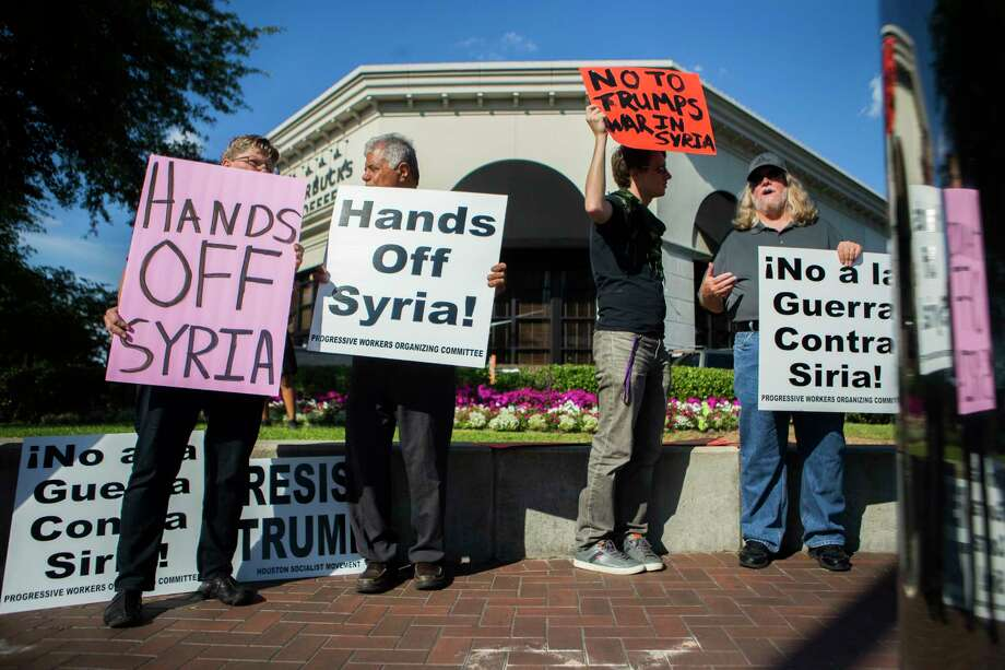 Pat Hartwell, left, Mahmoud Olya, Fabian Sneevliet and David Michael Smith protest against attacks on Syria, Friday, April 7, 2017, in Houston. Photo: Marie D. De Jesus, Houston Chronicle / © 2017 Houston Chronicle