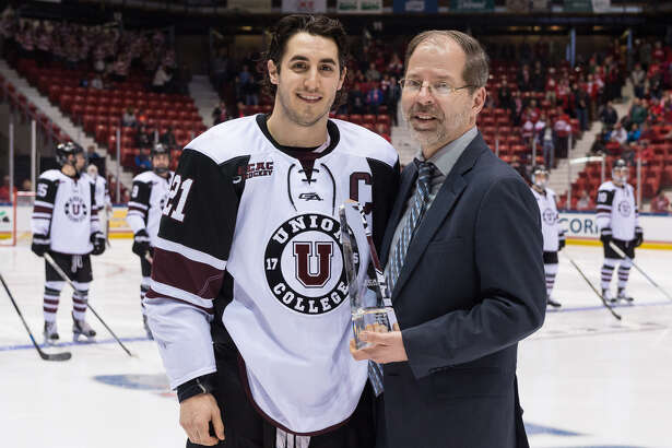 Mike Vecchione of Union receives the ECAC Hockey Player of the Year Award from ECAC commissioner Steve Hagwell prior to Friday's semifinal game against Cornell in Lake Placid. (John DiGiacomo / Placid Times Photography) ORG XMIT: MER2017031721152240
