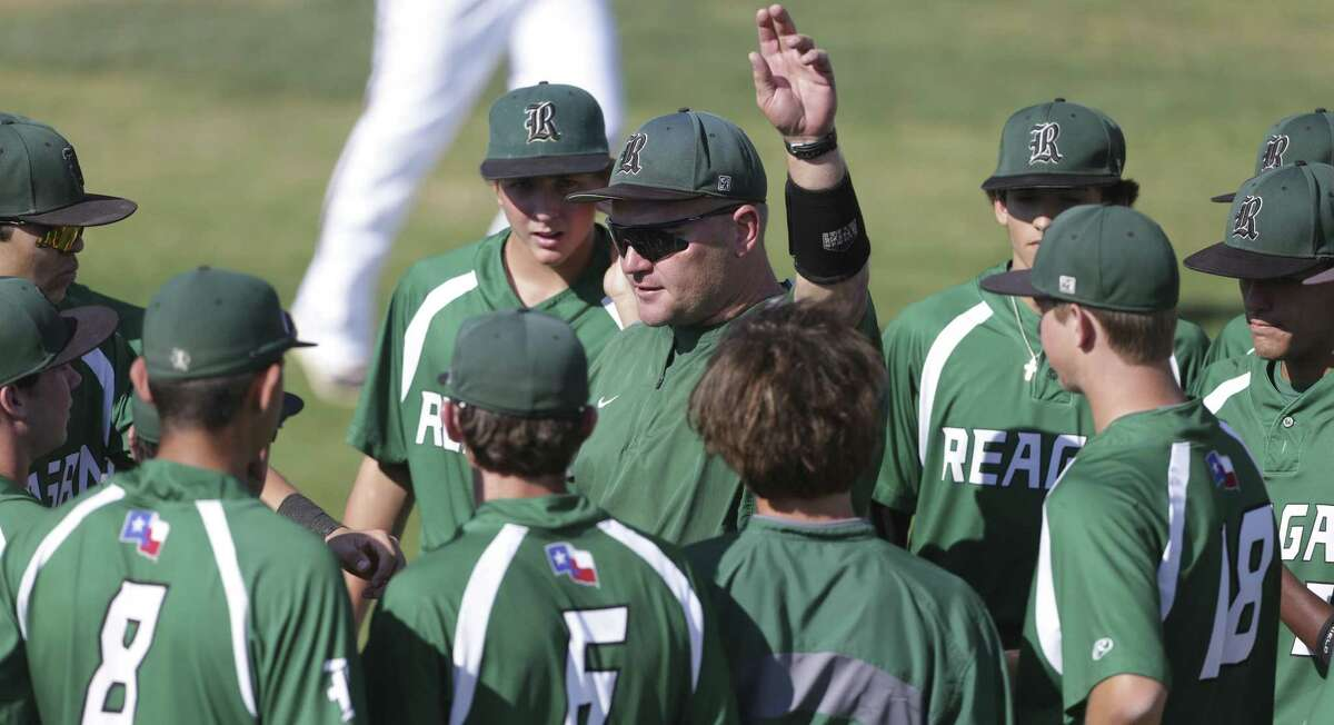 Coach Chans Chapman works with the Rattlers as Churchill beats Reagan 10-4 in boys baseball at Blossom Athletic Center on April 7, 2017.