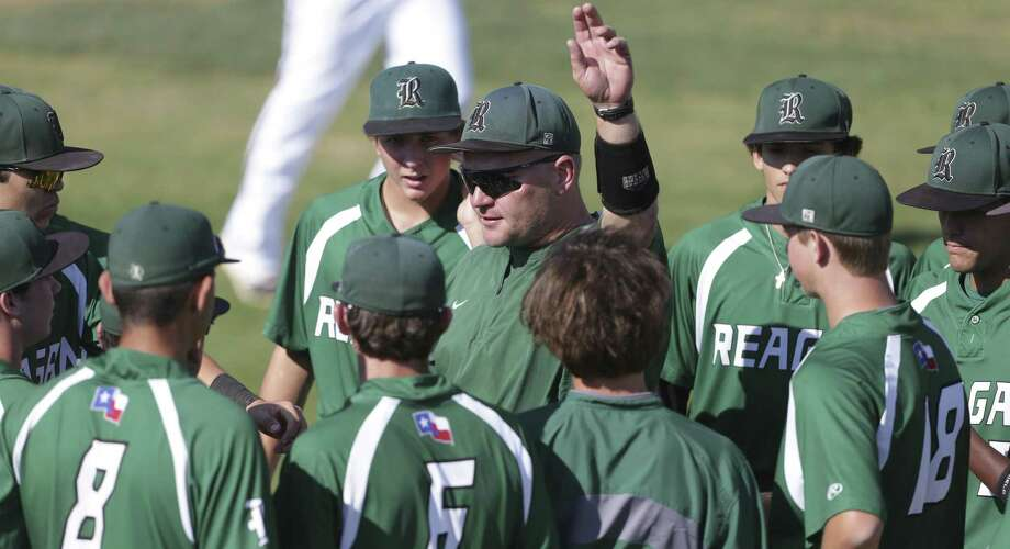 Coach Chans Chapman works with the Rattlers as Churchill beats Reagan 10-4 in boys baseball at Blossom Athletic Center  on April 7, 2017. Photo: Tom Reel, Staff / San Antonio Express-News / 2017 SAN ANTONIO EXPRESS-NEWS