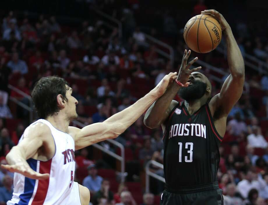 Houston Rockets guard James Harden (13) is fouled by Detroit Pistons center Boban Marjanovic (51) during the second quarter of an NBA basketball game at Toyota Center on Friday, April 7, 2017, in Houston. ( Brett Coomer / Houston Chronicle ) Photo: Brett Coomer/Houston Chronicle