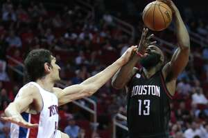 Houston Rockets guard James Harden (13) is fouled by Detroit Pistons center Boban Marjanovic (51) during the second quarter of an NBA basketball game at Toyota Center on Friday, April 7, 2017, in Houston. ( Brett Coomer / Houston Chronicle )