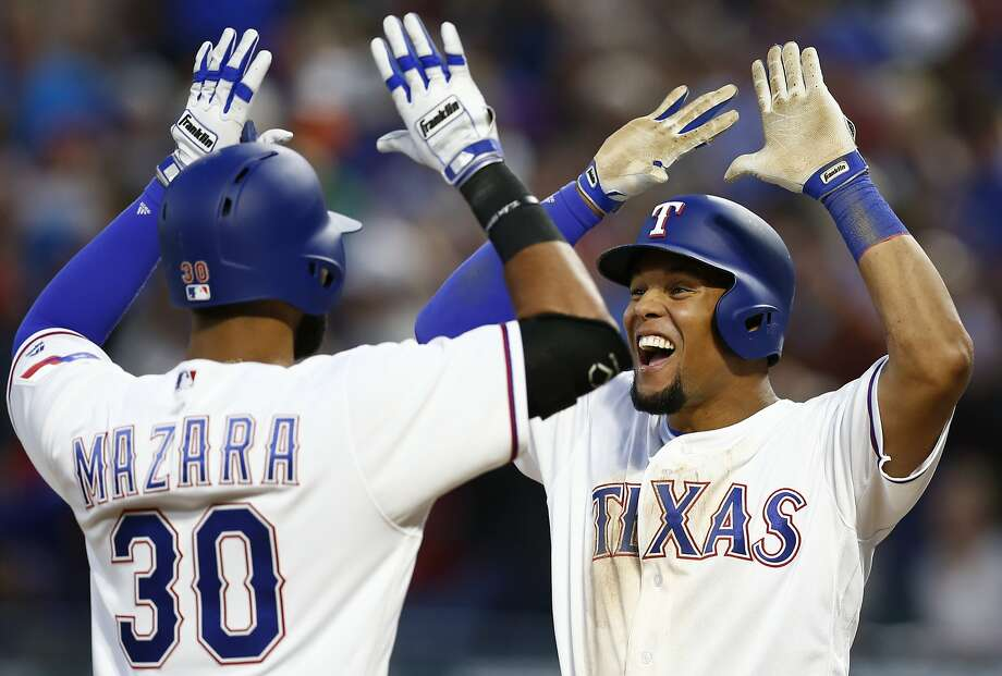 Texas Rangers' Nomar Mazara (30) celebrates his grand slam with Carlos Gomez against the Oakland Athletics during the second inning of a baseball game, Friday, April 7, 2017, in Arlington, Texas. (AP Photo/Jim Cowsert) Photo: Jim Cowsert, Associated Press
