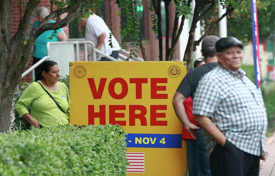 Harris County officials are urging voters to cast early ballots this year for the upcoming November elections. More than three dozen polling sites were damaged by Hurricane Harvey and may not be available for Election Day, Nov. 7. Here, voters gather on the last day of early voting last November in Conroe. Photo: Jason Fochtman, Staff Photographer / Houston Chronicle