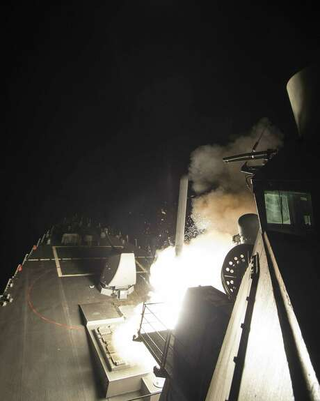 The USS Ross fires a Tomahawk land attack missile on Friday from the  Mediterranean Sea. The United States blasted a Syrian air base with a barrage of cruise missiles. (U.S. Navy via Getty Images) Photo: U.S. Navy, Handout / 2017 U.S. Navy