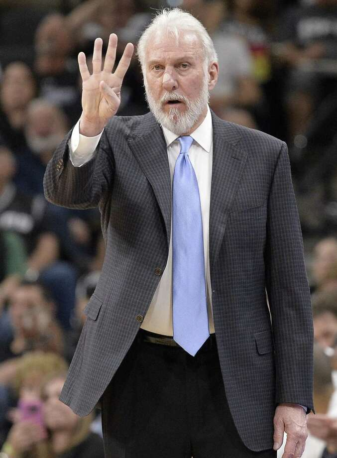San Antonio Spurs head coach Gregg Popovich signals to his players during the second half of an NBA basketball game against the Memphis Grizzlies, Tuesday, April 4, 2017, in San Antonio. San Antonio won 95-89 in overtime. (AP Photo/Darren Abate) Photo: Darren Abate, FRE / Associated Press / FR115 AP