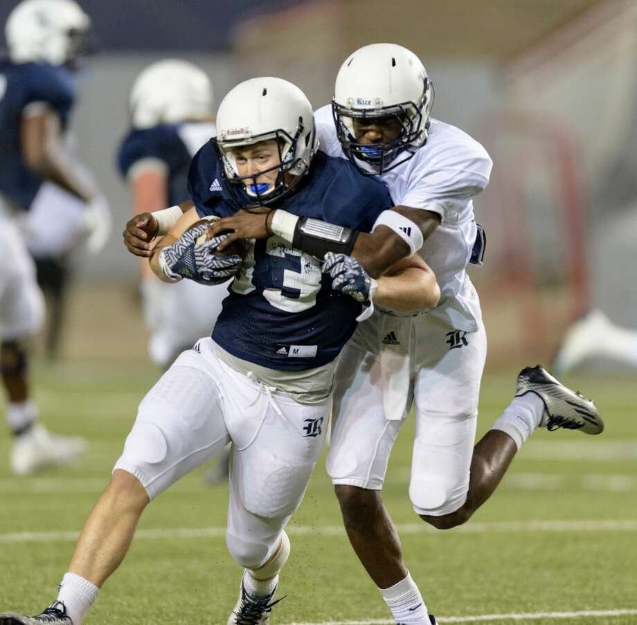 Rhett Cardwell (83) of the Rice Owls is brought down by D'Angelo Ellis (12) after a reception and short run in the Rice Owls Spring Football game on Friday, April 7, 2017 at Rice Stadium in Houston Texas. Photo: Wilf Thorne/For The Chronicle