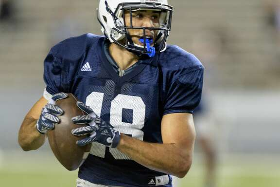 Kylen Granson (18) of the Rice Owls looks to pass the ball after a short end around in the first half in the Rice Owls Spring Football game on Friday, April 7, 2017 at Rice Stadium in Houston Texas.