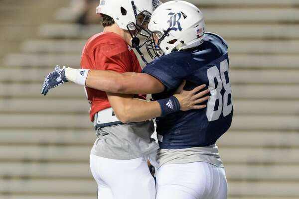 Sam Glaesmann (4) of the Rice Owls congratulates Robby Wells III (88) after his touchdown in the first half of the Rice Owls Spring Football game on Friday, April 7, 2017 at Rice Stadium in Houston Texas.