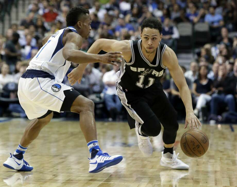 San Antonio Spurs guard Bryn Forbes (11) drives against Dallas Mavericks guard Yogi Ferrell during the second half of an NBA basketball game in Dallas, Friday, April 7, 2017. (AP Photo/LM Otero) Photo: LM Otero/Associated Press