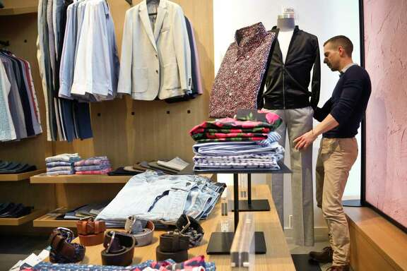 Stephen Lusardi arranges clothing at a New York Bonobos store. Retail jobs are declining.