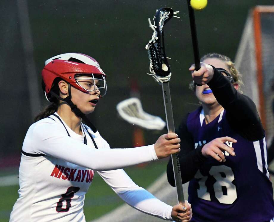 Niskayuna's #8 CJ Havery, left, gets the ball past John Jay's #18 Annie Carway during their game at Union College's Bailey Field  Friday April 7, 2017 in Schenectady, NY.  (John Carl D'Annibale / Times Union) Photo: John Carl D'Annibale / 20040183A
