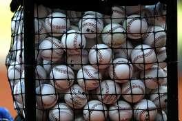 Baseballs sit in a basket during Astros batting practice before the start of an MLB baseball game at Minute Maid Park, Friday, April 7, 2017, in Houston.   ( Karen Warren / Houston Chronicle )
