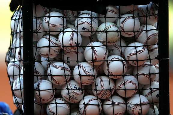 Baseballs sit in a basket during Astros batting practice before the start of an MLB baseball game at Minute Maid Park, Friday, April 7, 2017, in Houston.   ( Karen Warren / Houston Chronicle )