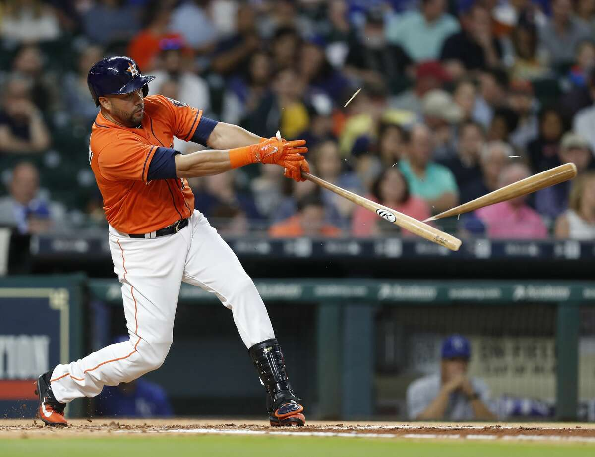 Houston Astros right fielder Carlos Beltran (15) shatters his bat on his single in the second inning of an MLB baseball game at Minute Maid Park, Friday, April 7, 2017, in Houston. ( Karen Warren / Houston Chronicle )