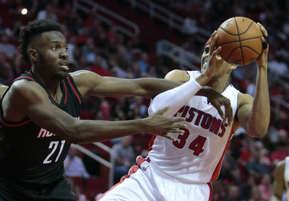 Houston Rockets forward Chinanu Onuaku (21) defends a drive to the basket by Detroit Pistons forward Tobias Harris (34) during the third quarter of an NBA basketball game at Toyota Center on Friday, April 7, 2017, in Houston. ( Brett Coomer / Houston Chronicle ) Photo: Brett Coomer/Houston Chronicle