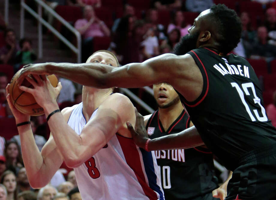 Detroit Pistons forward Henry Ellenson (8) is fouled by Houston Rockets guard James Harden (13) during the fourth quarter of an NBA basketball game at Toyota Center on Friday, April 7, 2017, in Houston. ( Brett Coomer / Houston Chronicle ) Photo: Brett Coomer/Houston Chronicle