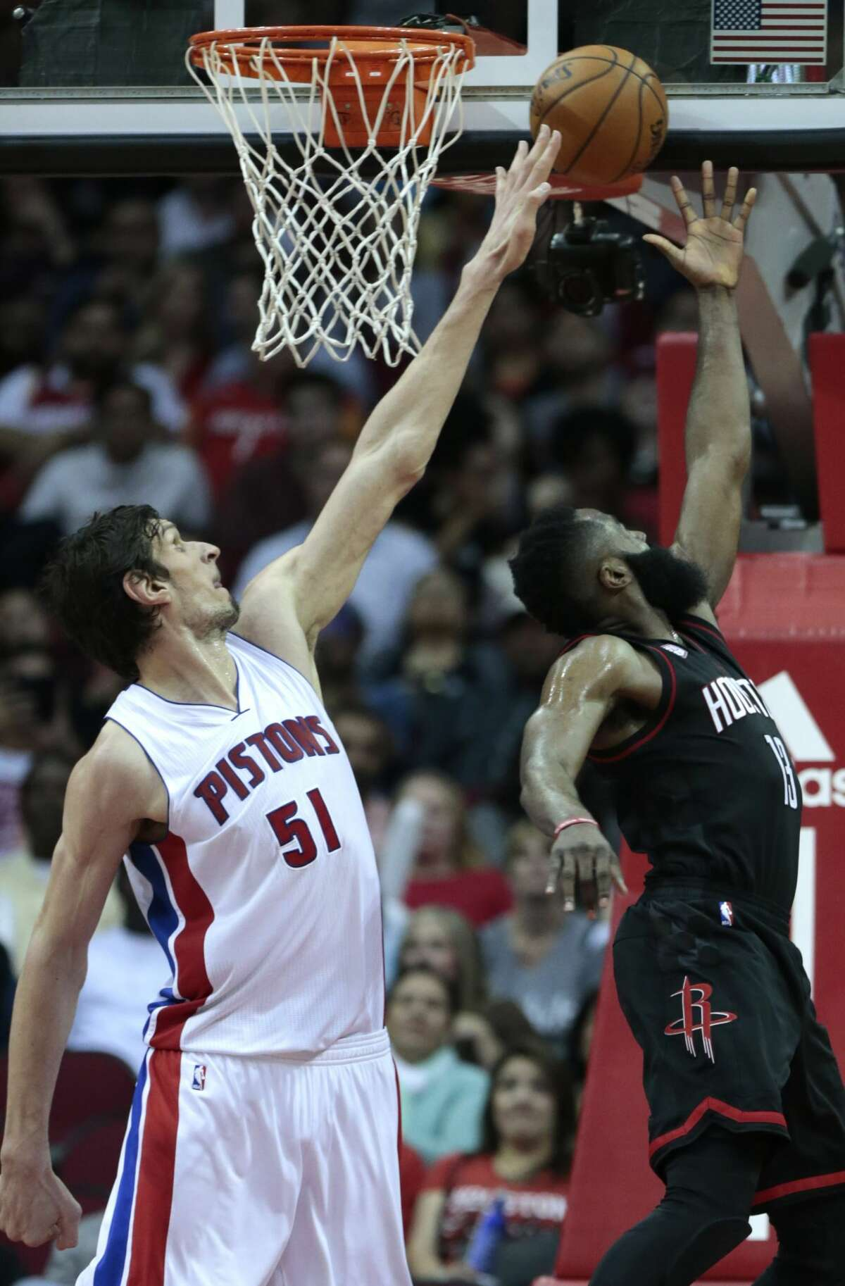 Detroit Pistons center Boban Marjanovic (51) defends a shot by Houston Rockets guard James Harden (13) during the third quarter of an NBA basketball game at Toyota Center on Friday, April 7, 2017, in Houston. ( Brett Coomer / Houston Chronicle )