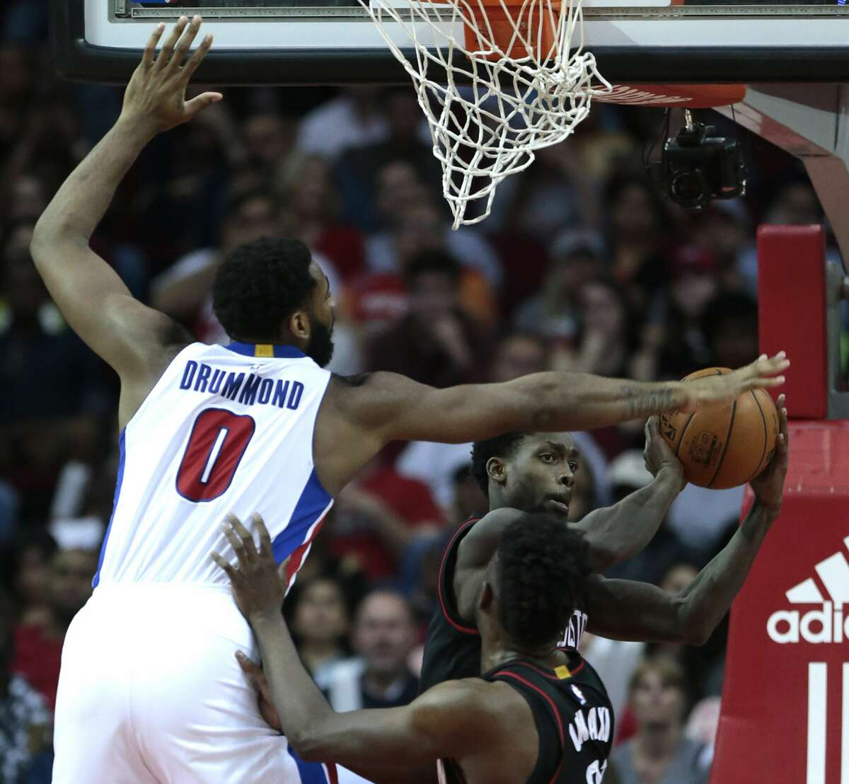 Houston Rockets guard Patrick Beverley (2) looks to pass under the basket defended by Detroit Pistons center Andre Drummond (0) during the fourth quarter of an NBA basketball game at Toyota Center on Friday, April 7, 2017, in Houston. ( Brett Coomer / Houston Chronicle )