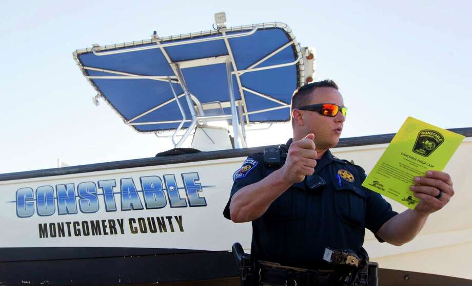Lt. Tim Cade, with Montgomery County Precinct 1 Constable's Office, talks about a new initiative with boaters where deputies perform pre-checks on individual boats prior to being launched on Lake Conroe on Friday in Conroe. During the checks, deputies will look for required safety measures, such as life vests or air horns, so boaters can enjoy more time on the lake, rather than be bothered by deputies while out on the lake. Photo: Jason Fochtman, Staff Photographer / © 2017 Houston Chronicle