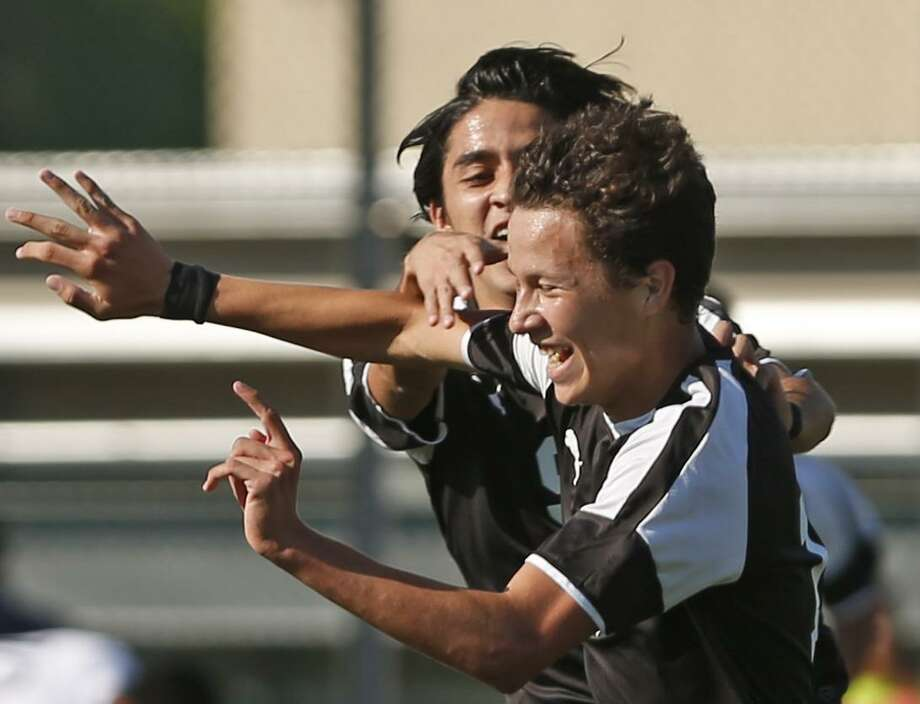 ClarkÕs Alex Villarreal celebrates with ClarkÕs Daniel Rodriguez,behind, after his goal in first half from the Region IV-6A semifinal boys soccer games between Clark-Edinburg North on Friday, April 7, 2017 at Blossom Soccer Stadium's West Field Photo: Ron Cortes, Freelance / For The San Antonio Express-News / Ronald Cortes / Freelance