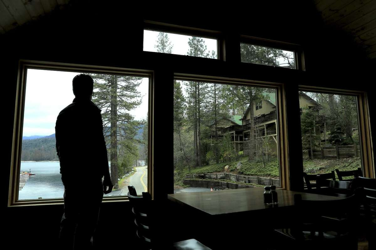 Wade Wheeler of Miller's Landing Resort in Bass Lake looks out over the property, where trees were saved by watering during the drought.