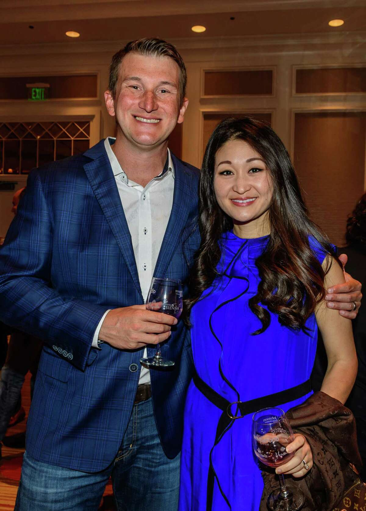 Adam and Susan Gonzales enjoy the Sugar Land Wine & Food Affair's Grand Tasting held in the Sugar Land Marriott ballroom, 04/07/17.