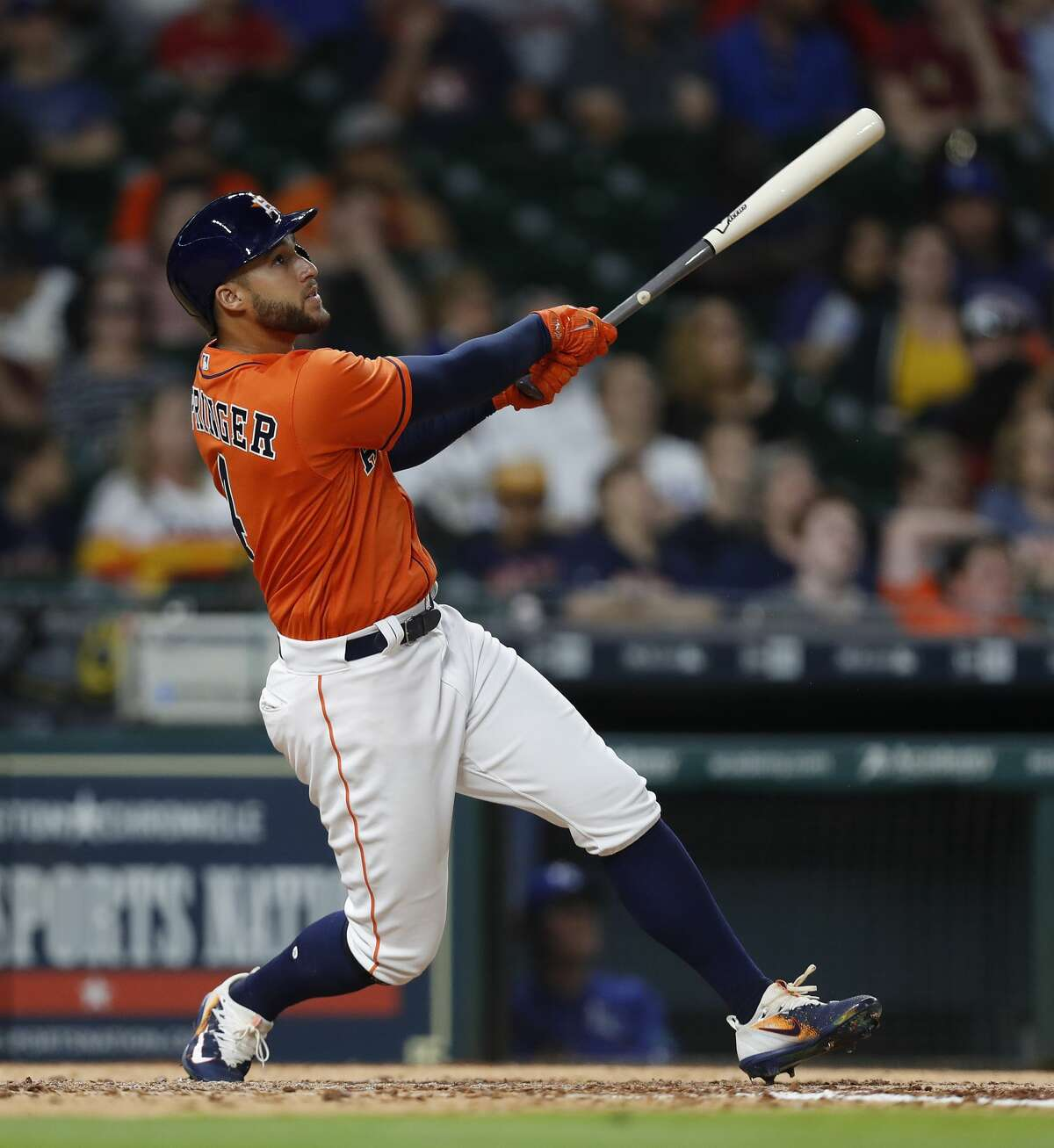 Houston Astros George Springer (4) watches his ball fly out to Kansas City Royals center fielder Lorenzo Cain (6) in the eighth inning of an MLB baseball game at Minute Maid Park, Friday, April 7, 2017, in Houston. ( Karen Warren / Houston Chronicle )