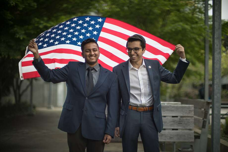 Pranav Jandhyala, 19, co-founded BridgeCal, a group seeking to bridge the political/ideological divide on campus and Naweed Tahmas, 20, is a member of the Berkeley College Republicans hold an American flag on Friday, April 7, 2017 in Berkeley, Calif.  They have invited ultra-conservative Ann Coulter to campus -- but Pranav is encouraging students with opposing views to attend and ask challenging questions. Photo: Paul Kuroda, Special To The Chronicle