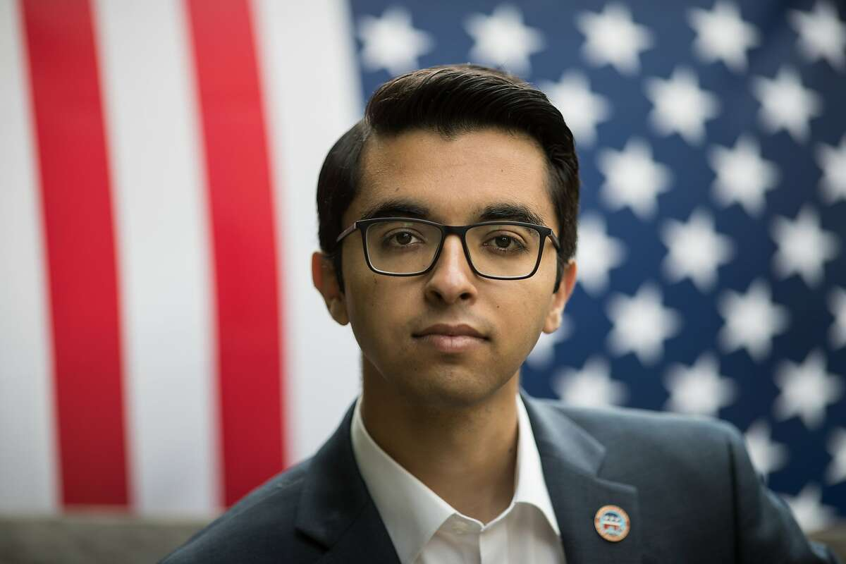 Naweed Tahmas, 20, is a member of the Berkeley College Republicans, pose in front of an American flag on Friday, April 7, 2017 in Berkeley, Calif.
