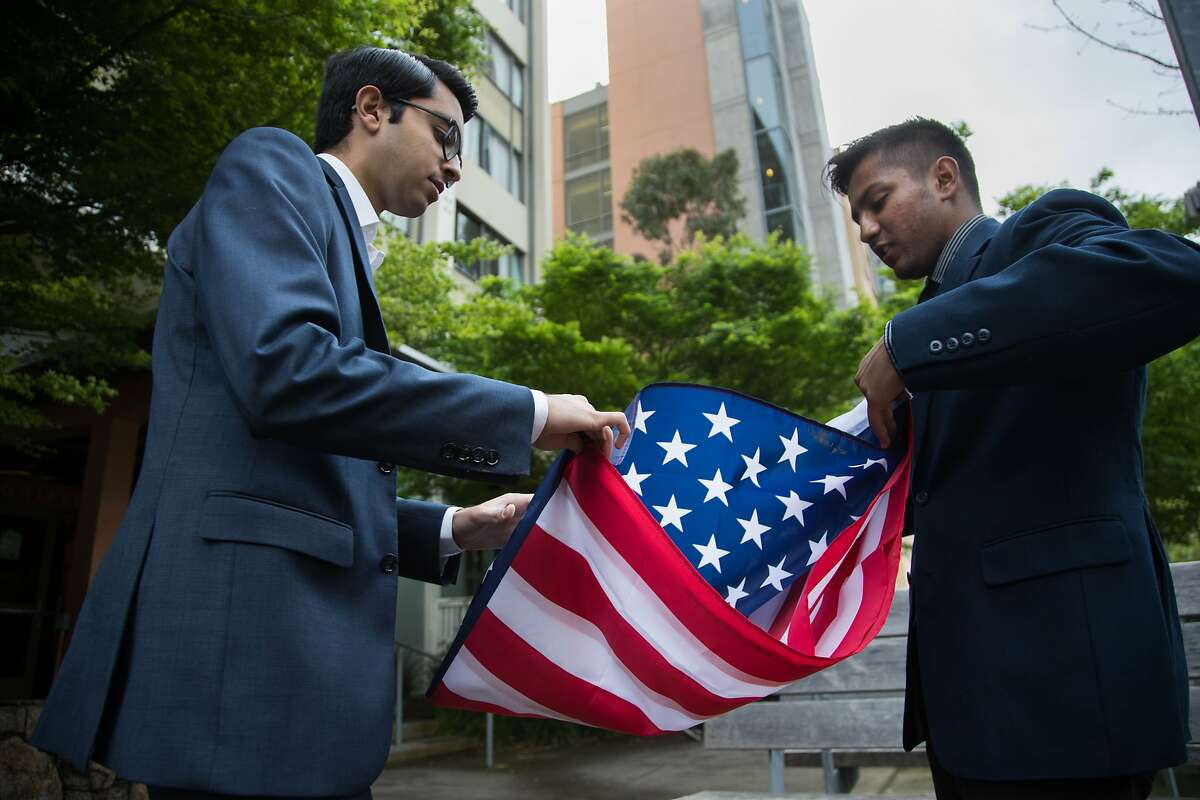 Naweed Tahmas, 20, is a member of the Berkeley College Republicans folds an American flag with Pranav Jandhyala, 19, co-founded BridgeCal, a group seeking to bridge the political/ideological divide on campus on Friday, April 7, 2017 in Berkeley, Calif. They have invited ultra-conservative Ann Coulter to campus -- but Pranav is encouraging students with opposing views to attend and ask challenging questions.