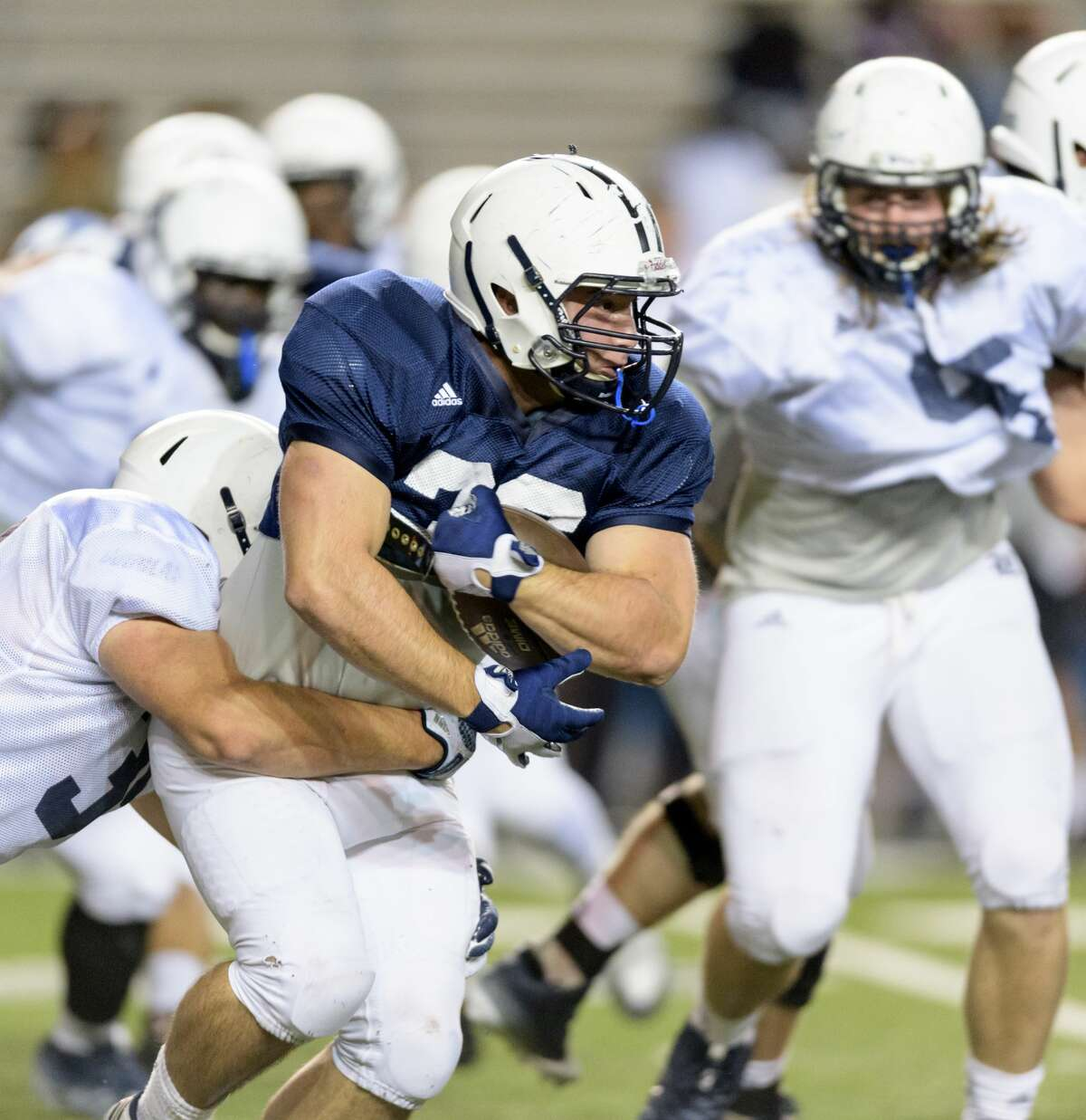 Paine Matiscik (36) of the Rice Owls runs the ball up the middle in the second half in the Rice Owls Spring Football game on Friday, April 7, 2017 at Rice Stadium in Houston Texas.