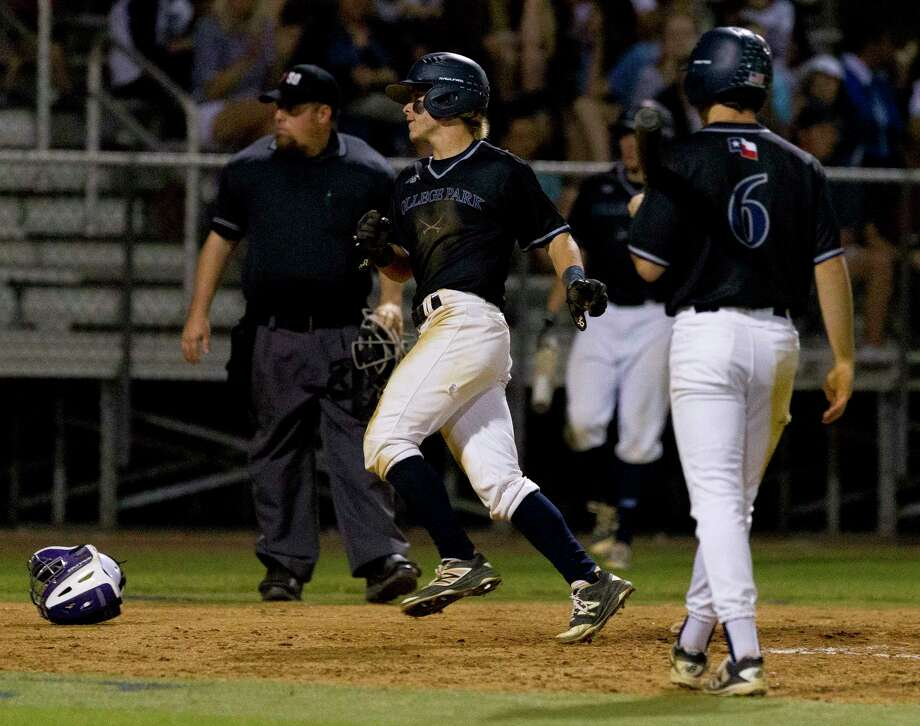 Michael Loggins #17 of College Park scores on a wild pitch  from Montgomery starting pitcher Gavin LaBruyere during the fourth inning of a District 12-6A high school baseball game Friday, April 7, 2017, in The Woodlands. Loggins reached first on an error early in the inning by shortstop Jordan Hood. Photo: Jason Fochtman, Staff Photographer / © 2017 Houston Chronicle