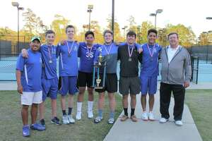 The Frassati Falcons boys tennis squad celebrates after a terrific TAPPS District III-3A meet in which all six varsity boys qualified for the state tournament in either singles or doubles play. The Falcons so thoroughly dominated the boys' side of the event that both the singles and doubles championship matches were all-Frassati affairs.
