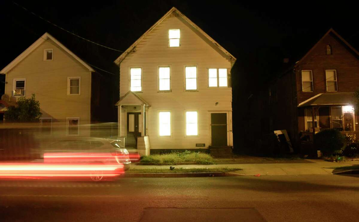 An abandoned house pulses with light on Victory Avenue as part of the Breathing Lights project on Thursday, Sept. 29, 2016, Schenectady, N.Y. (Cindy Schultz / Times Union)