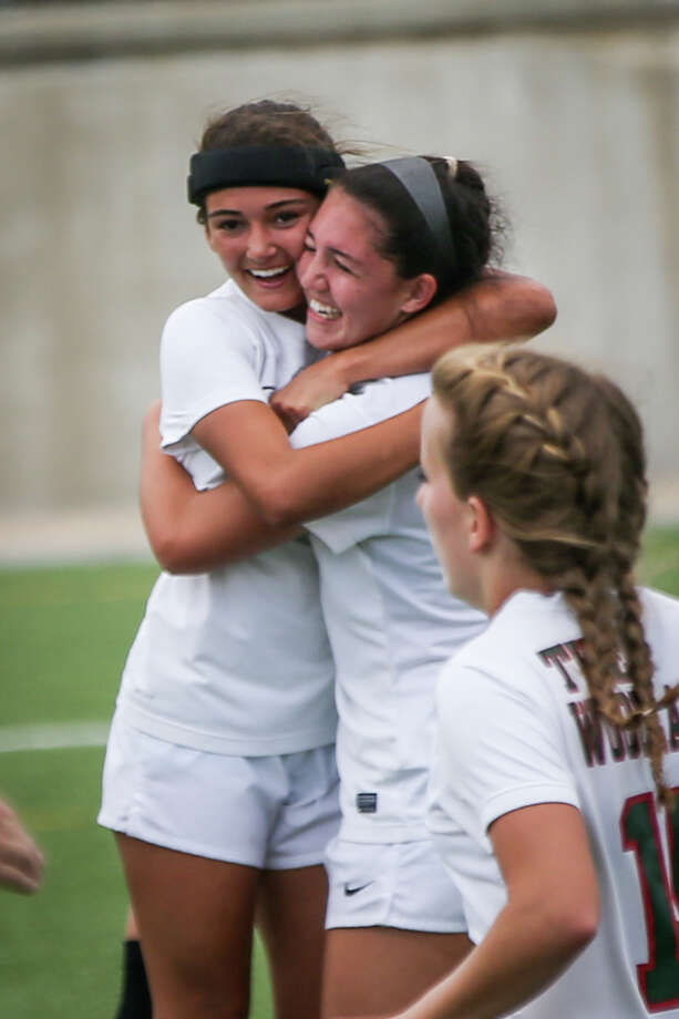 The Woodlandsé• Kate McCullough (2) celebrates with teammate Aliyah Hale (9) after scoring a goal during the varsity girls soccer game against Hendrickson on Saturday, April 8, 2017, at Kelly Reeves Stadium in Austin. (Michael Minasi / Houston Chronicle) Photo: Michael Minasi, Staff Photographer / © 2017 Houston Chronicle