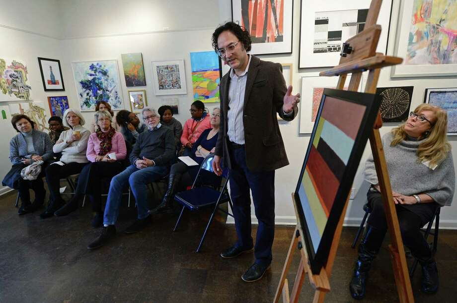 Riad Miah, an award-winning New York artist and educator, leads participants in a conversation about artwork he judged for RAC's Abstraction – Abstracts exhibit as The Norwalk Arts Commission, in partnership with the Rowayton Arts Center hosts this year's SLOW Art Day program on Saturday, April 8, 2017, at the Rowayton Arts Center in Norwalk, Conn.  The international program has grown from 16 museums and galleries in 2009 to more than 190 worldwide in 2016. Photo: Erik Trautmann / Hearst Connecticut Media / Norwalk Hour