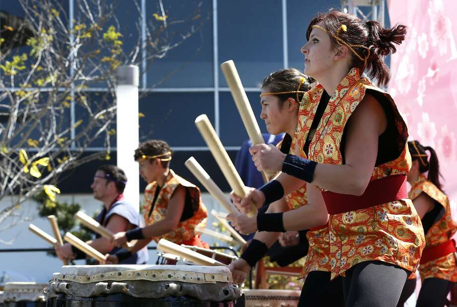 The San Francisco Taiko Dojo drummers perform for a crowd at the 50th annual Cherry Blossom Festival in San Francisco's Japantown. Photo: Paul Chinn, The Chronicle