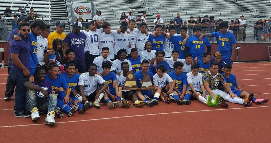 The Wheatley and Washington boys soccer teams pose for a combined photo following Wheatley's 6-2 win in the Class 4A Region III championship Saturday at A&M Consolidated. The all-HISD region final was a first in district history. Photo: Meagan Pena