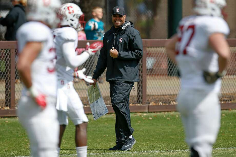 Stanford head coach David Shaw smiles as play runs through some drills during spring football practice on Saturday, April 8, 2017 in Stanford. Photo: Tony Avelar, Special To The Chronicle
