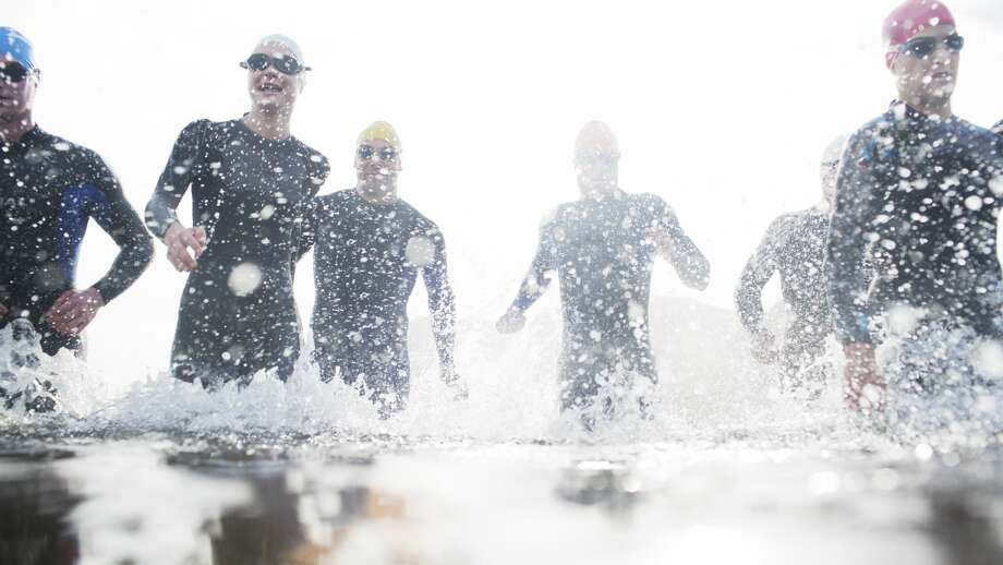 File photo of traithletes. One person was hospitalized and 30 others suffered from symptoms of hypothermia during the HITS Napa Valley triathlon in Napa County on Saturday morning.   Photo: Paul Bradbury/Getty Images/Caiaimage