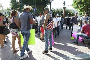 Cubans stranded in Nuevo Laredo, Mexico gather at Plaza Juarez in the border city to hold a rally and march from the plaza to the International Bridge, on Saturday, April. 8, 2017.