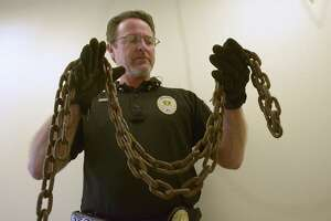 Shannon Sims, assistant director of Animal Care Services, holds a heavy chain that was taken off of a medium sized dog in San Antonio. Sims testified at the capital about proposed House Bill 1156 that mirrors the City of San Antonio ordinance that makes it an offense to unlawfully restrain a dog.